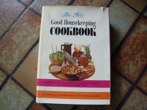 This is what the dust jacket looks like - I lost mine so long ago, I don't remember, but there's more then one image of this on the vintage cookbook e-bay place....
