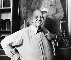 James Beard in front of a portrait of...James Beard