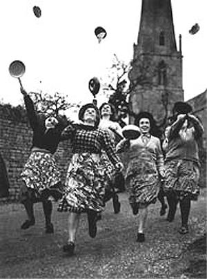 Flipping pancake in Olney England