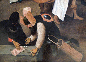 This is a detail from a Pieter Bruegel painting about Carnevale. Notice the waffles as headgear!