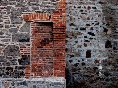 bricked doorway in vintage stone wall
