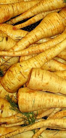 Parsnips won't have much green this time of year, and the rind will definitely need peeling. They are said to be sweeter after a frost. But in the summer, you eat them smaller, so it rather evens all out.