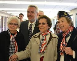 She's the second from the left, reading to give a hand....this was from last Veteran's Day