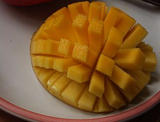 cut in half, discard pit (or try to root it - I got a little shoot growing out once, but then the cats played wit it one night...)and then cut slices one and and across but not through the skin - pop up and serve...with extra napkins  - mangoes are JUICY