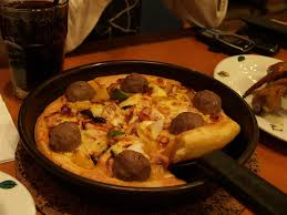 Is it less pizza if it's made in a skillet? I've done this, it's good pizza.